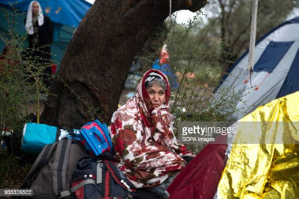 An Afghan asylumseeker waits outside Moria Camp where she and hundreds of others were told they must register after arriving in Greece In 2015 more...