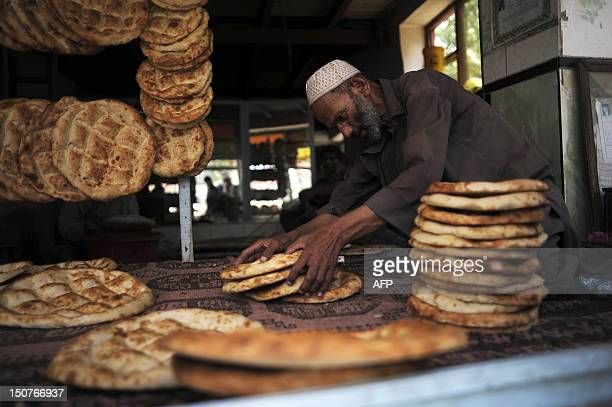 An Afghan baker sells bread at a shop in Kabul on August 26 2012 Over a third of Afghans are living in abject poverty as those in power are more...