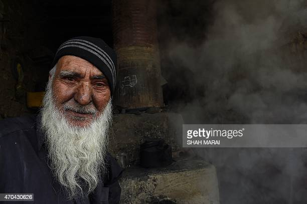 An Afghan blacksmith looks on as he works at his shop in the capital Kabul on April 20 2015 AFP PHOTO / SHAH Marai