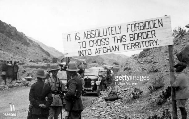 An Afghan border crossing at the Khyber Pass manned by British troops during the Third AngloAfghan War it is marked by a sign which reads 'it is...