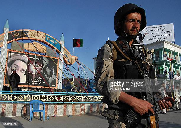 An Afghan border policeman keeps watch in front of the Hazrat Ali Shrine in the northern town of MazariSharif in Balkh province on March 20 2009 Tens...