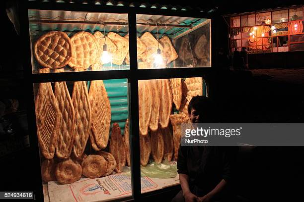 An Afghan boy sells traditional bread on a road side in Kabul Afghanistan on October 312014