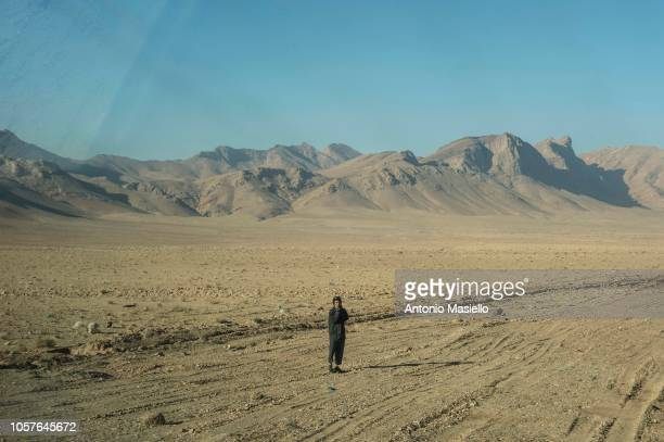 An Afghan boy walks on the street during a route clearance operation of Italian soldiers of the 11° Reggimento Genio Guastatori in the Herat area on...