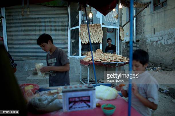 An Afghan bread seller on the street during the holy month of Ramadan on August 7 2011 in Kabul Afghanistan The Islamic holy month of Ramadan is...