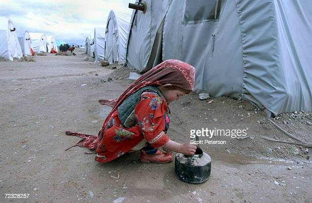 An Afghan child plays at Maslach refugee camp February 21 2002 in western Afghanistan More than 113000 Afghans displaced by drought and war crowd the...