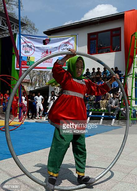 An Afghan children of The Mobile Mini Circus for Children performs in Kabul on April 20, 2014. Children from The Mobile Mini Circus for Children...