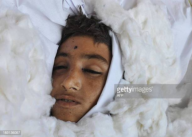 An Afghan civilian allegedly killed in a NATO air strike is pictured in a coffin on the outskirts of Jalalabad in Nangarhar province on October 5...