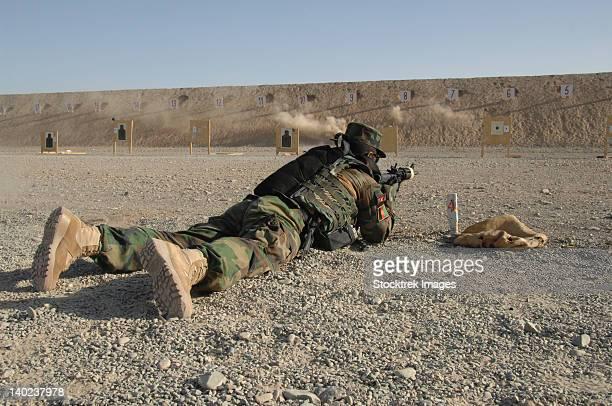 an afghan commando engages training targets on the firing range. - objetivo militar imagens e fotografias de stock