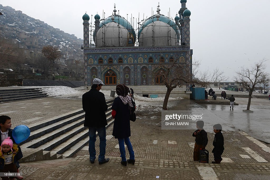 An Afghan couple walks at the Karti Sakhi Shrine in Kabul on February 14, 2013. Afghan couples have to go to uncrowded areas like cemeteries and hilltops to find time alone as relations with the opposite sex outside of marriage are taboo. Valentine's Day passes mainly unnoticed in strictly Islamic Afghanistan. AFP PHOTO/ SHAH Marai