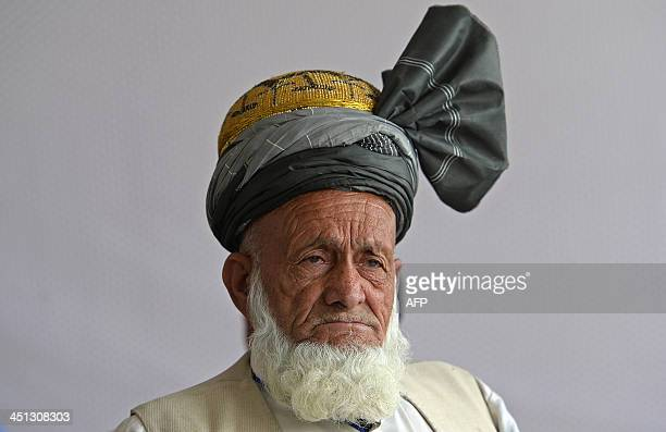 An Afghan delegate listens during a discussion on the Bilateral Security Agreement during a fourday loya jirga a meeting of around 2500 Afghan tribal...