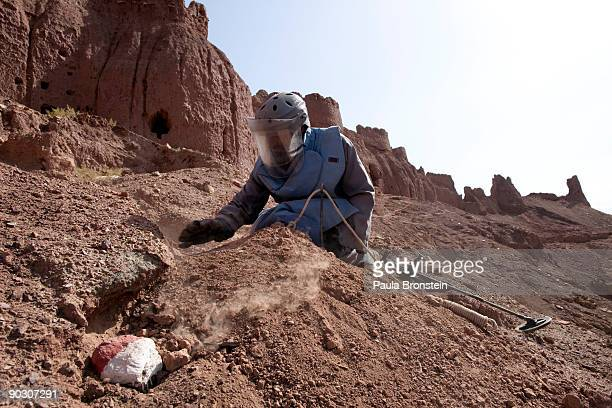An Afghan deminer clears the dirt away as he works at the archaelogical site of ShahriZohak September 2 2009 in Bamiyan Afghanistan Afghan Technical...