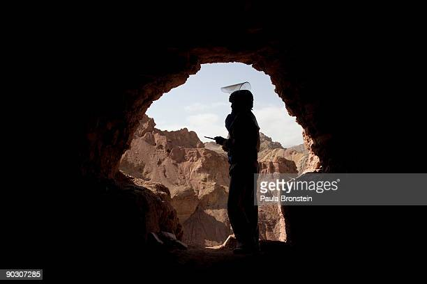 An Afghan deminer stands in the entrance to a cave at the archaelogical site of Shahr-i-Zohak September 2 , 2009 in Bamiyan, Afghanistan. Afghan...