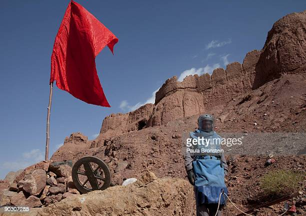An Afghan deminer takes a break working on top of the archaelogical site of Shahr-i-Zohak September 2 , 2009 in Bamiyan, Afghanistan. Afghan...