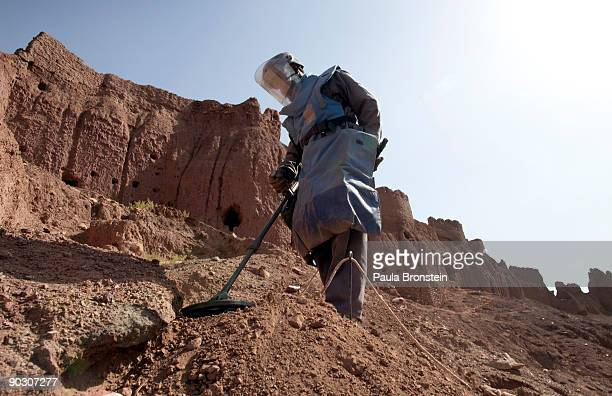 An Afghan deminer uses a metal detector working on top of the archaelogical site of Shahr-i-Zohak September 2 , 2009 in Bamiyan, Afghanistan. Afghan...