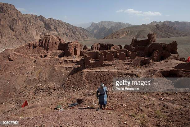 An Afghan deminer uses a metal detector working on top of the archaelogical site of Shahr-i-Zohak September 2, 2009 in Bamiyan, Afghanistan. Afghan...