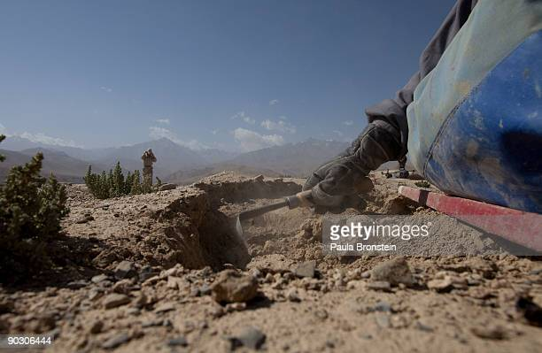 An Afghan deminer uses a small tool to dig searching for mines and other munition on top the archaelogical site of Shahr-i-Gholghola September 2 ,...