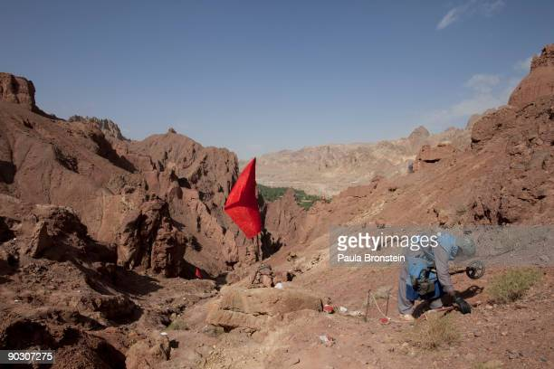 An Afghan deminer works on top of the archaelogical site of Shahr-i-Zohak September 2 , 2009 in Bamiyan, Afghanistan. Afghan Technical Concultants...