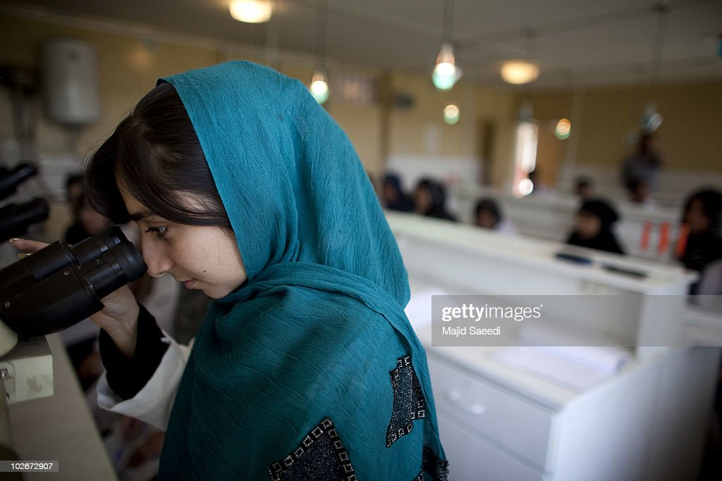 An Afghan female student attends Kabul university on July 6, 2010 in Kabul, Afghanistan. The change in the status of women in Afghanistan has changed since the Taliban regime where women were forced to wear the burqa in public. The face of a woman was considered a source of corruption for men not related to them. They were not allowed to work and not allowed to be educated after the age of eight and then only permitted to study the Qur'an. Women wanting to be educated were forced to attend underground schools such as the Golden Needle Sewing School and along with their teachers risked execution if caught. They also were not allowed to be treated by male doctors unless accompanied by a male chaperone often leading to illnesses remaining untreated. Women faced public flogging and execution for violations of the Taliban's laws.