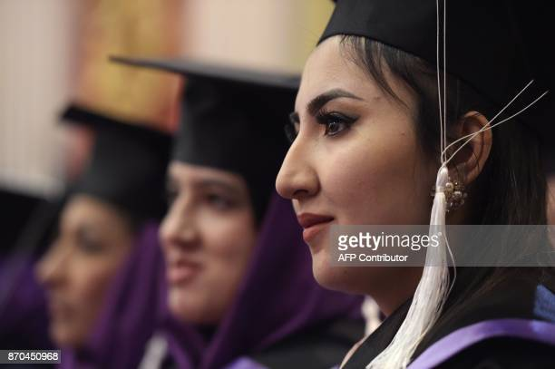 An Afghan female student looks on during the graduation ceremony of the firstever class of Gender and Womens studies master's programme in Kabul on...