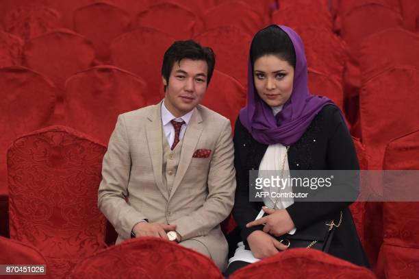 An Afghan female student poses with her fiance for a photograph before the graduation ceremony of the firstever class of Gender and Womens studies...