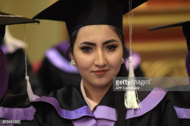 An Afghan female student smiles during the graduation ceremony of the firstever class of Gender and Womens studies master's programme in Kabul on...