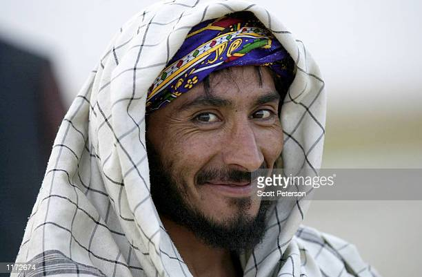 An Afghan fighter of the Northern Alliance waits as American aircraft shell their enemy the Islamic Taliban militia October 23 2001 at the Rabat...