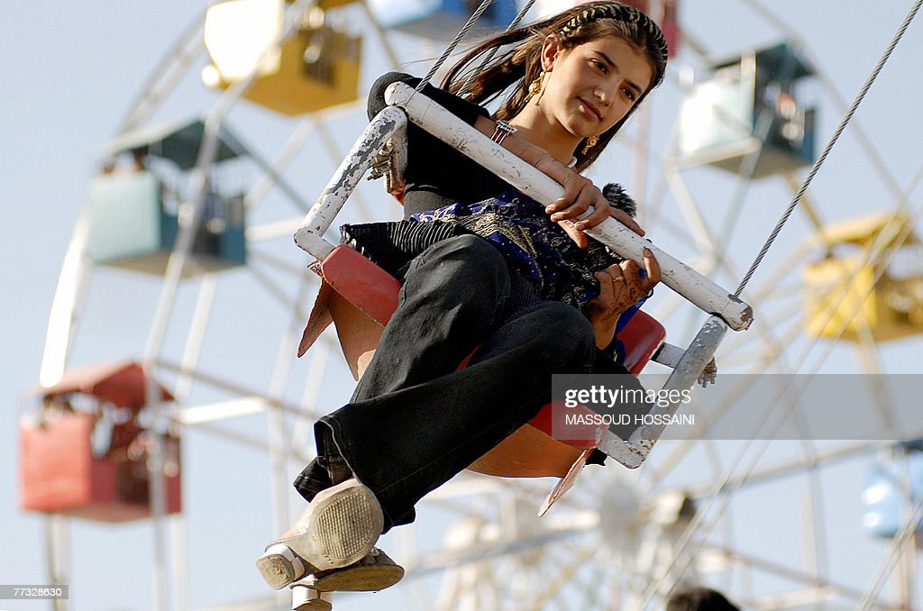 An Afghan girl enjoys a ride at an amusement park in Kabul, 14 October 2007, on the occaision of Eid-al-Fitr. The three-day festival, which begins after the sighting of a new crescent moon, marks the end of the Muslim fasting month of Ramadan, during which devout Muslims abstain from food, drink, smoking and sex from dawn to dusk. AFP PHOTO/MASSOUD Hossaini