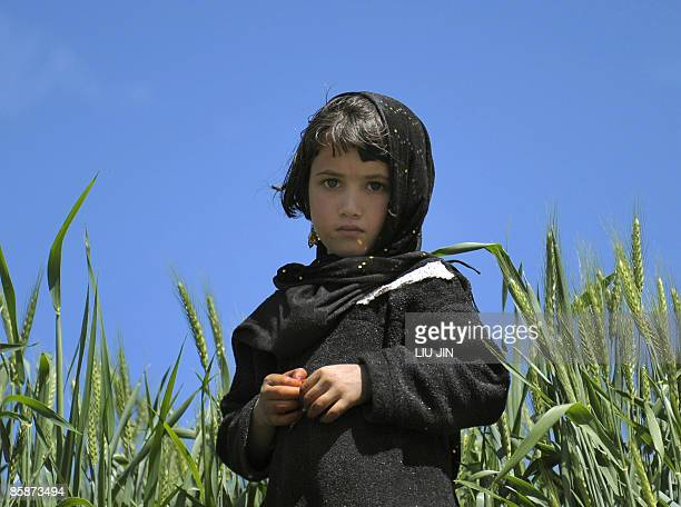An Afghan girl is pictured in Naray town, located in Afghanistan's eastern Kunar province, on April 9, 2009. US President Barack Obama, announcing...