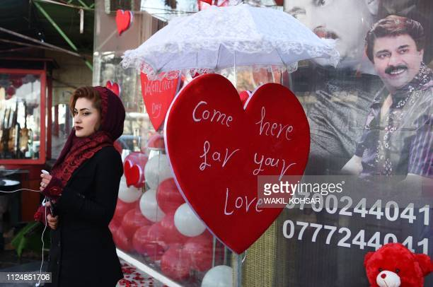 An Afghan girl looks on as she buy gifts during Valentine's Day in the ShareNaw area of Kabul on February 14 2019 In conservative Afghanistan many...