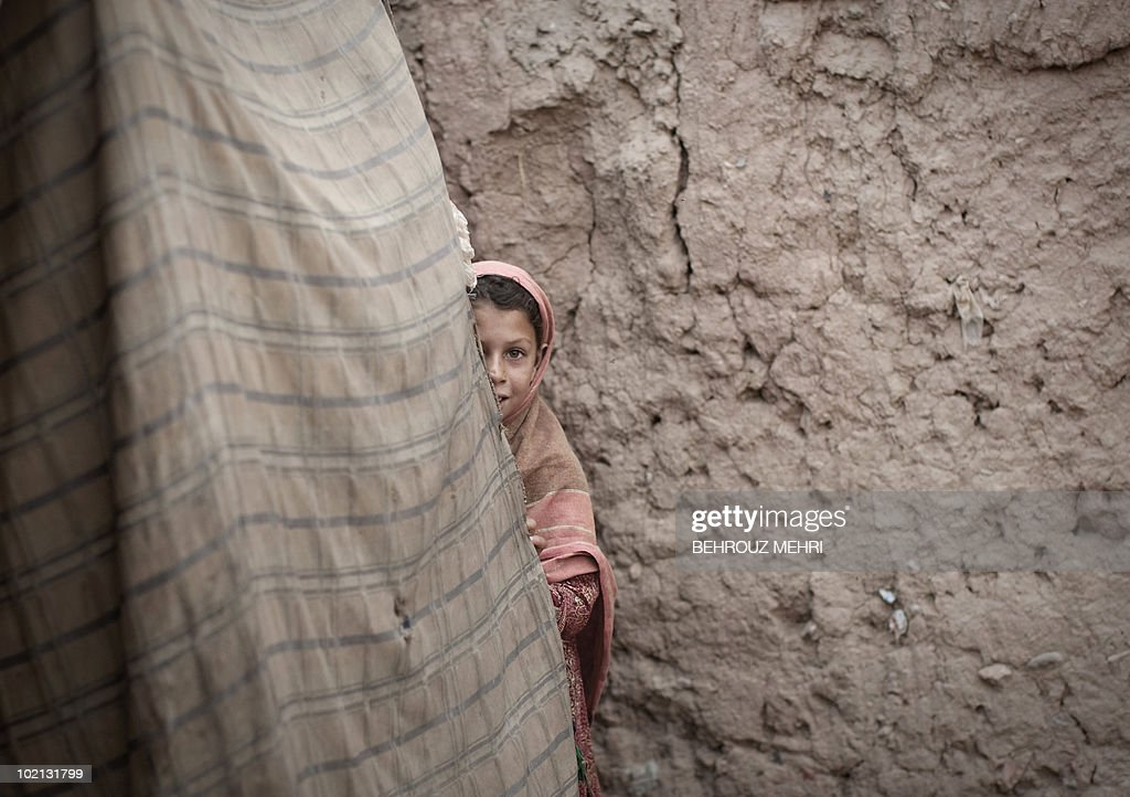 An Afghan girl looks on in a slum area in Islamabad on June 15, 2010. Pakistan approached the International Monetary Fund in 2008 and has secured a 11.3 billion USD standby loan in an effort to contain inflation and cope with a rapid depletion of reserves that were barely enough to cover nine weeks of import bills.