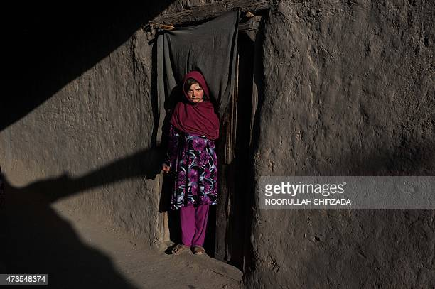 An Afghan girl looks on in the old section of Jalalabad in Nangarhar province on May 15 2015 AFP PHOTO / Noorullah SHIRZADA