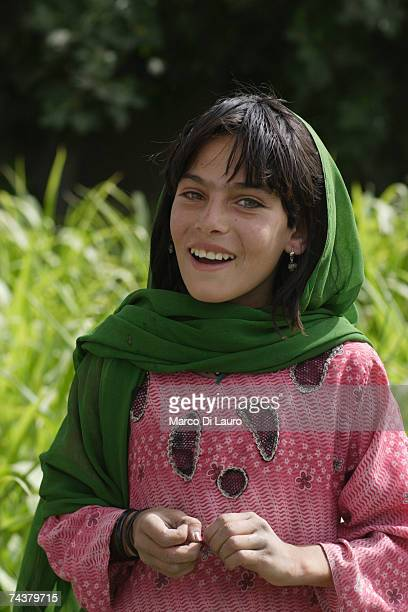 An Afghan girl smiles as British Soldiers and ANA passes by during 'Lastay Kulang' Operation' on June 1 2007 in Sangin Valley Helmand Province...