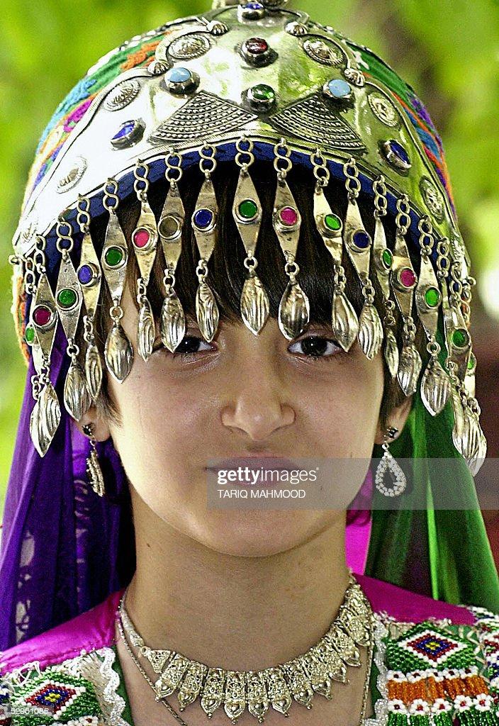 An Afghan girl wearing traditional jewellery and headdress