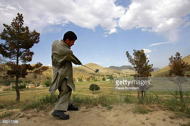 An Afghan golfer tees off on the 2nd hole at the Kabul Golf Club June 3, 2005 in Kabul, Afghanistan. The Kabul Golf Club has been in operation since...