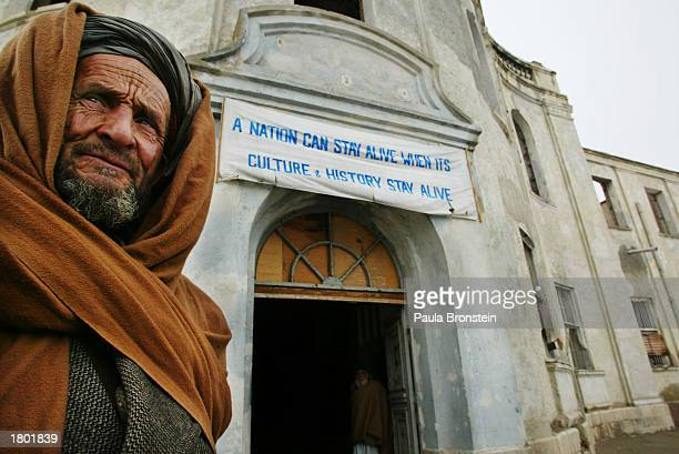 An Afghan guard stands outside the Kabul Museum February 18 2003 in Kabul Afghanistan The museum which was extensively damaged through the previous...