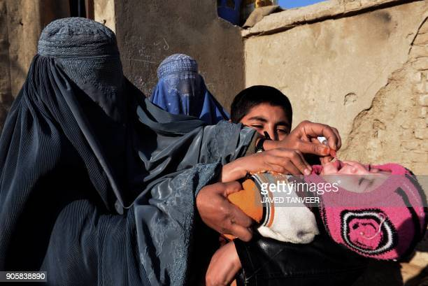 An Afghan health worker administers the polio vaccine to a child during a vaccination campaign in Kandahar on January 17 2018 Polio once a worldwide...