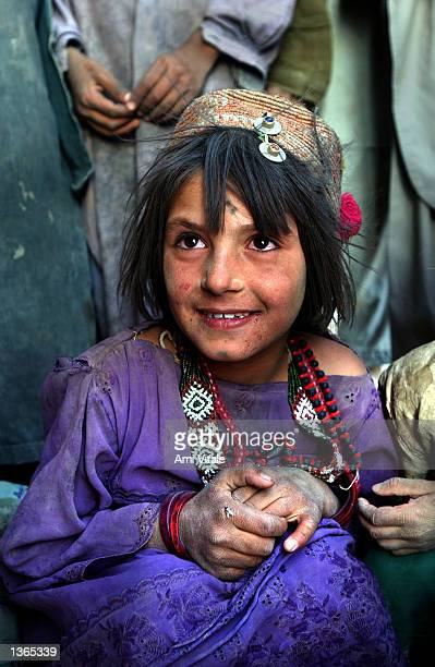 An Afghan Kuchi nomad girl who was living in camps around Spin Boldak near the border of Pakistan in southern Afghanistan relaxes after a grueling...