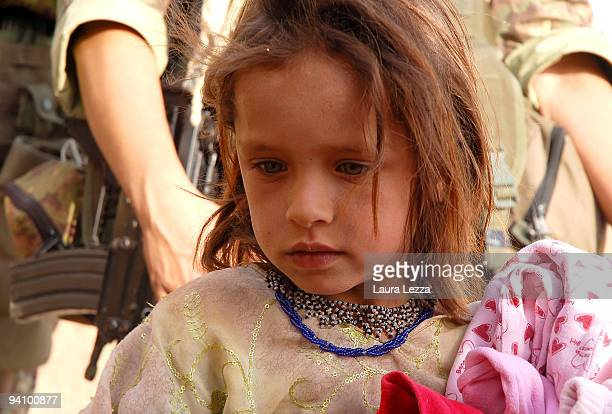 An afghan little girl during a visit of soldiers of the Folgore Parachute Brigade into a small and remote village on September 16 2009 off the city...