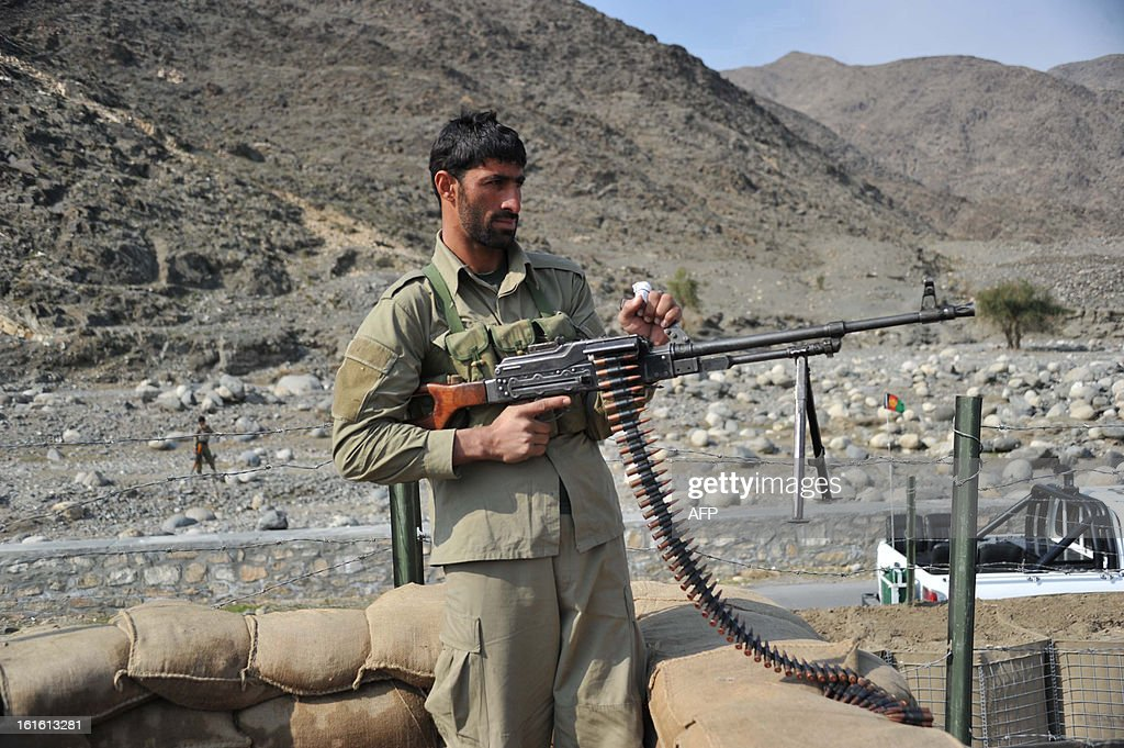 An Afghan Local Police (ALP) personnel keeps watch during a patrol in Nor Gal district Kunar province on February 13, 2013. The Afghan government welcomed President Barack Obama's announcement that the United States will withdraw 34,000 troops from the war-torn country over the next year. NATO, which has about 37,000 troops in Afghanistan, will also withdraw them in stages before the end of 2014. AFP PHOTO/ Noorullah Shirzada