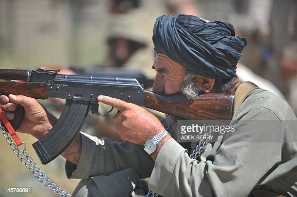 An Afghan local policeman fires his AK47 rifle during a training session conducted by US Marines from 1st battalion 7th Marines Regiment at Forward...