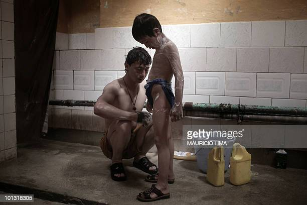 An Afghan man bathes his son at a traditional hamam bathhouse in Kabul on April 30 2010 Mostly Afghans come in the morning for onehour sessions...