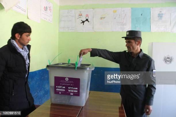 An Afghan man casts her vote at a polling center in Badakhshan Afghanistan 20 October 2018 According to the Independent Election Commission about...