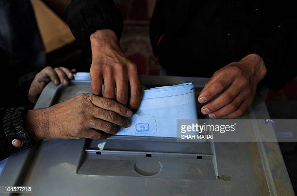 An Afghan man casts his vote at a polling station in Kabul on September 18 2010 Afghanistan was voting for a new parliament September 18 against a...