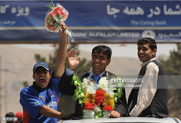 An Afghan man celebrates as he welcomes the national cricket team upon their return to the country following their qualification for the ICC World...