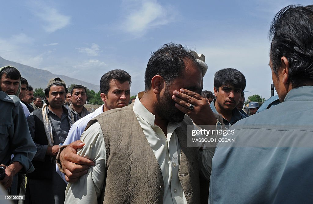 An Afghan man cries after losing one of his family members in a plain crash in Charikar city of Parwan province, north of capital Kabul on May 21, 2010. Bodies and wreckage of an Afghan passenger plane that crashed with 43 people on board have been found on a mountainside with no immediate sign of any survivors, a government minister said. The ageing Pamir Airways plane was carrying three Britons, an American and dozens of Afghans when it came down during bad weather on May 17 during a scheduled flight from the northern province of Kunduz to Kabul. AFP PHOTO/Massoud HOSSAINI