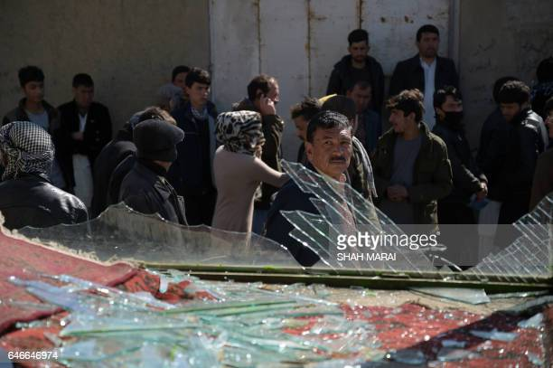 TOPSHOT An Afghan man looks on at the site of a suicide car bombing in Kabul on March 1 2017 Explosions and gunfire echoed through Kabul in two...