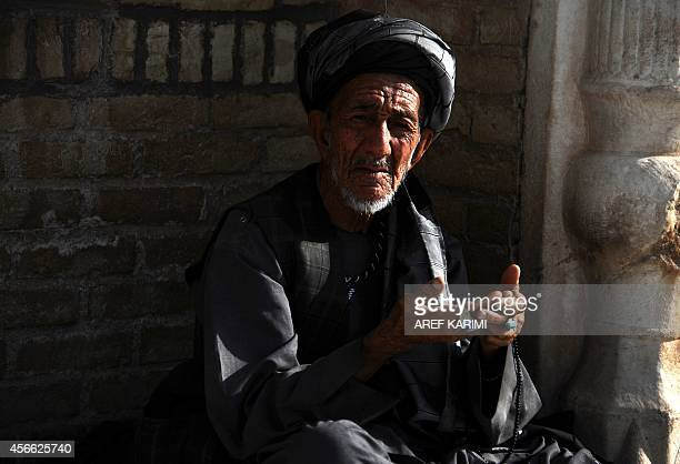 An Afghan man offers Eid alAdha prayers at the Blue Mosque in Herat on October 4 2014 Afghans started celebrating Eid alAdha or Feast of the...