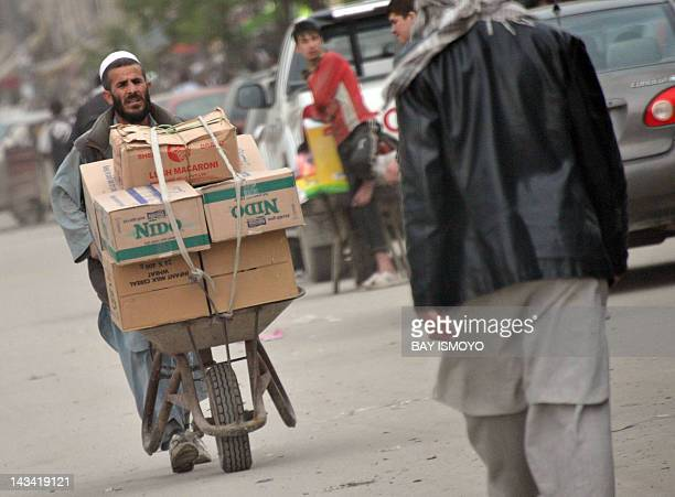 An Afghan man pushes a wheelbarrow laden with goods in Kabul on April 26 2012 Afghanistan's economy has been supported by huge infusions of Western...