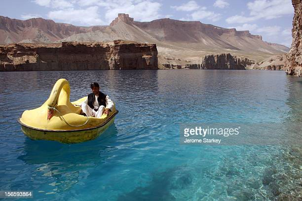 An Afghan man relaxes onboard a swan shaped pedalo on Band-e-Amir lake, in Bamyan Province, central Afghanistan. The lakes, which are formed by a...