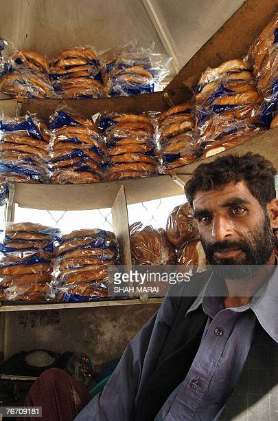 An Afghan man selling breads waits for customers at a busy market on the first day of Ramadan in Kabul 13 September 2007 Islam's holy month of...